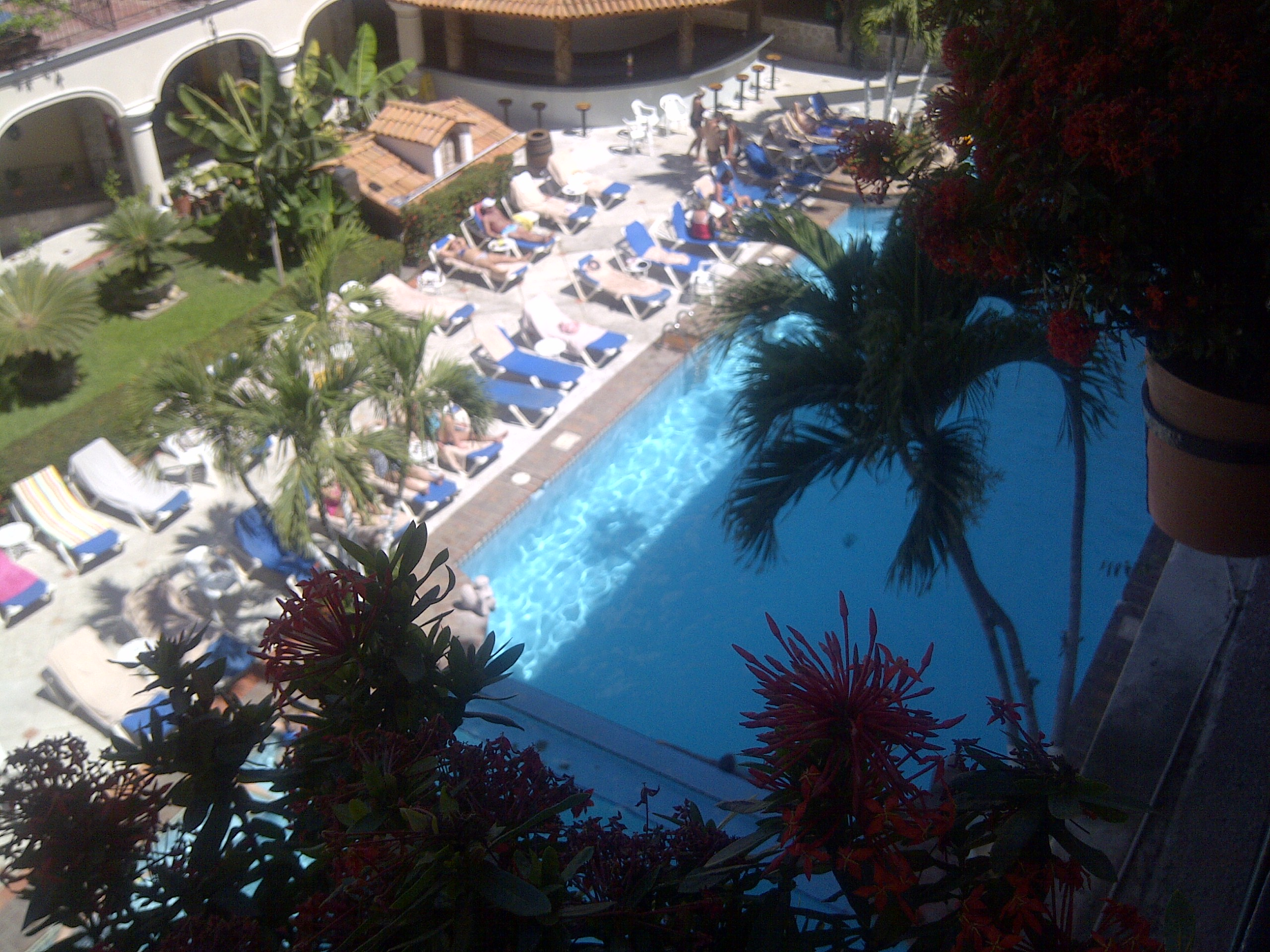 An early morning view of the Los Arcos pool area from our third floor room (before the chairs were filled with people!)